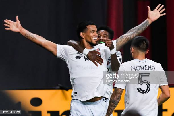 Gelmin Rivas of D.C. United reacts alongside Oniel Fisher and Junior Moreno after scoring a goal in extra time during the second half of a game...