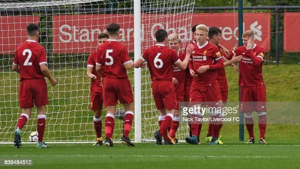 Geln McAuley of Liverpool celebrates his first goal with team mates Jordan Hunter Adam Lewis Anthony Glennon Liam Coyle Edvard Sandvik Tagseth Curtis...