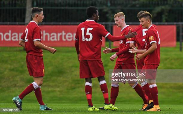 Geln McAuley of Liverpool celebrates his second goal with team mates Jordan Hunter Rafael Camacho Anthony Glennon and Adam Lewis during the Liverpool...
