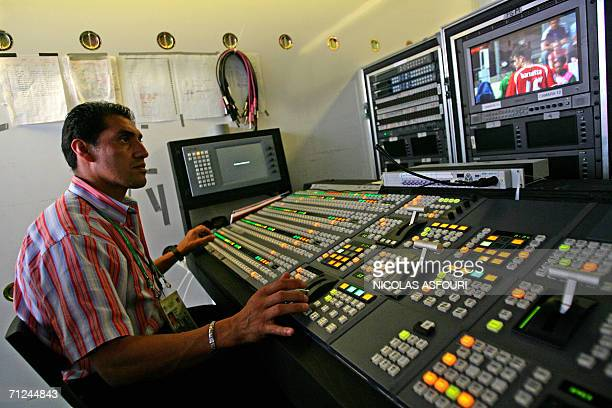Gelsenkirchen, GERMANY: A member of Mexican television channel TV Azteca prepares their equipment in a mobile studio van at the FIFA World Cup...