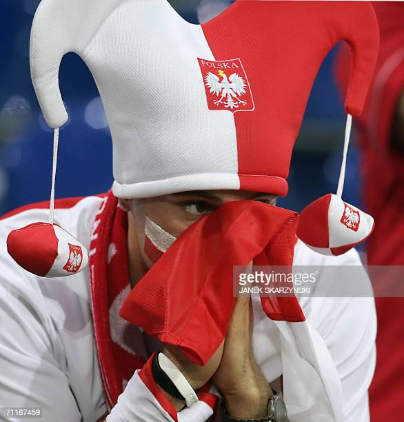 A Polish supporter looks dejected at the end of the Fifa World Cup 2006 group A football match Poland vs Ecuador 09 June 2006 at Gelsenkirchen...