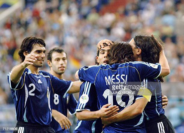 Argentinian forward Lionel Messi celebrates with teammates after scoring during the FIFA World Cup 2006 group C World Cup football match Argentina vs...