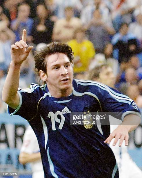 Argentinian forward Lionel Messi celebrates after scoring during the FIFA World Cup 2006 group C World Cup football match Argentina vs...