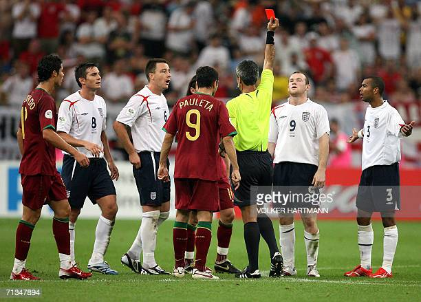 Argentinian referee Horacio Elizendo gives a red card to English forward Wayne Rooney as English defender Ashley Cole English defender John Terry...