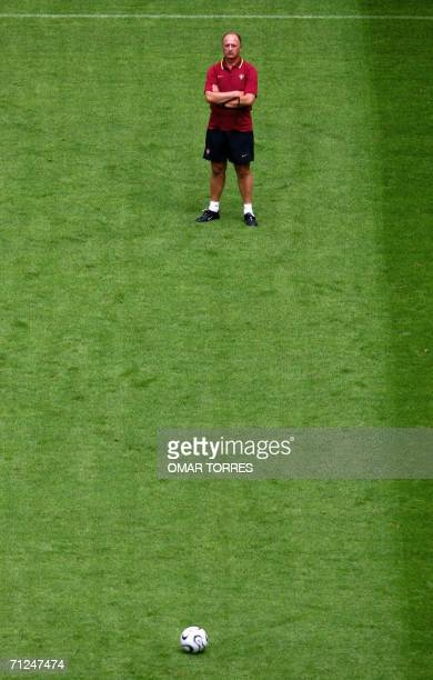 Brazilian head coach of the Portuguese football team Luiz Felipe Scolari watches his players as they take part in a team training session at the...