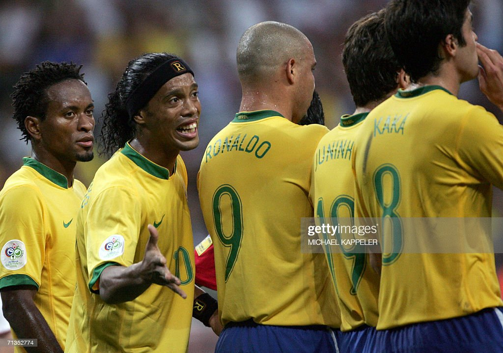 Brazilian player Ronaldinho (2ndL) gestures next to team-mates (from L) Ze Roberto, Ronaldo, Juninho and Kaka 01 July 2006 during the World Cup 2006 quarter-final football game England vs. Portugal at Gelsenkirchen stadium. Brazilians across the country crawled out of bed 02 July with their eyes dried from so much crying after watching France shatter their dreams of another World Cup victory.