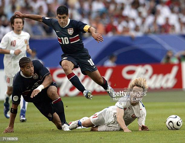 Czech Republic's Pavel Nedved is fouled by United States defender Oguchi Onyewu as USA's Claudio Reyna jumps over during the World Cup Group E...
