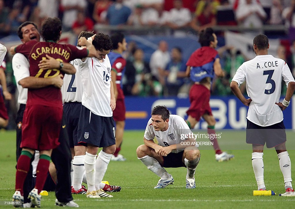 English defender Ashley Cole, teammates midfielder Frank Lampard and midfielder Owen Hargreaves look dejected at the end of the the World Cup 2006 quarter final football game England vs. Portugal, 01 July 2006 at Gelsenkirchen stadium. Portugal won 3-1 on penalties.