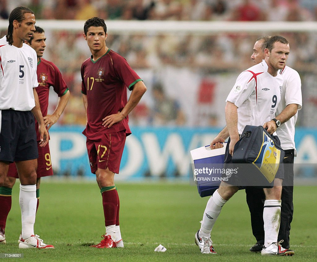 English forward Wayne Rooney (R) leaves the pitch after his red card next to Portuguese forward Cristiano Ronaldo (C) during the World Cup 2006 quarter final football game England vs. Portugal, 01 July 2006 at Gelsenkirchen stadium.
