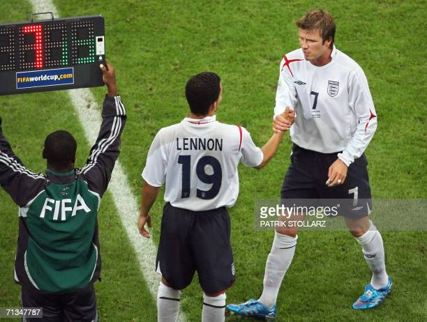English midfielder David Beckham leaves the pitch for a substitution with English midfielder Aaron Lennon during the World Cup 2006 quarter final...