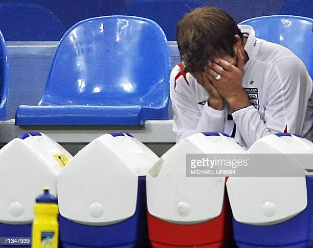 English midfielder David Beckham reacts after being injured during the World Cup 2006 quarter final football game England vs Portugal 01 July 2006 at...