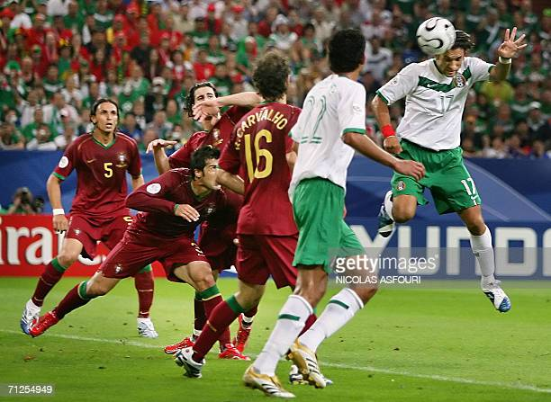 Mexican forward Francisco Fonseca heads the ball to score a goal despite Portuguese defender Ricardo Carvalho during the World Cup 2006 group D...