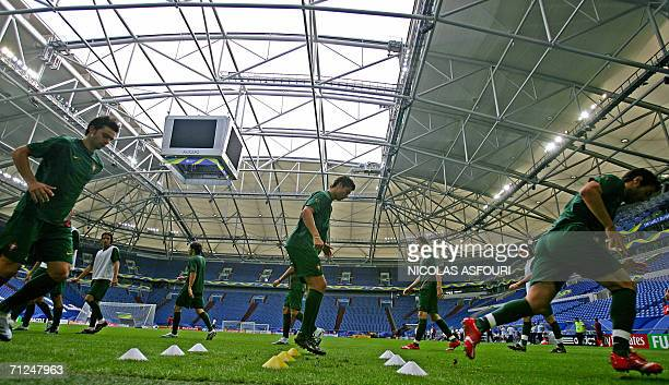 Portugal's football player Cristiano Ronaldo warms up during a team training session at the FIFA World Cup stadium in Gelsenkirchen 20 June 2006...