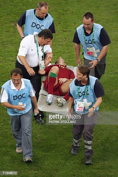 Portuguese defender Ricardo Carvalho is evacuated after being stamped on groin during the World Cup 2006 quarter final football game England vs...