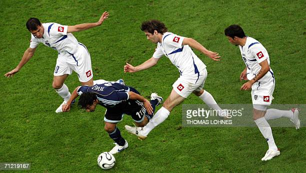 Serbian and Montenegran footballers Dejan Stankovic Ivan Ergic and Mateja Kezman try to stop Argentinian Carlos Tevez during the FIFA World Cup 2006...