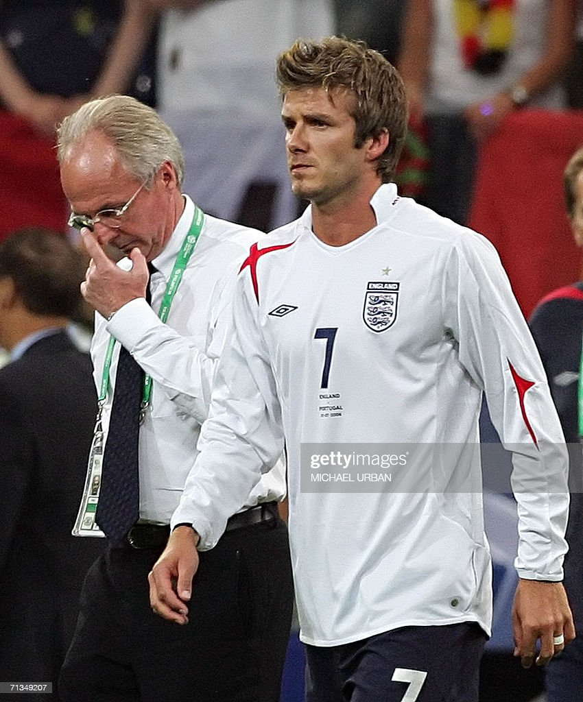 Swedish head coach of the English team Sven-Goran Eriksson (L) and English midfielder David Beckham look dejected at the end of the World Cup 2006 quarter final football game England vs. Portugal, 01 July 2006 at Gelsenkirchen stadium. Portugal won 3-1 on penalties.