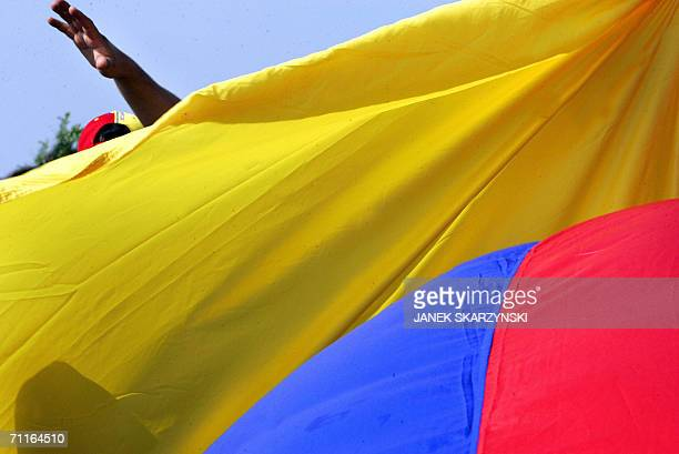 The hand of an Ecuadorean fan with his national flag joking in front of the Auf Shalke Arena in Gelsenkirche 09 June 2006 before the 2006 Football...