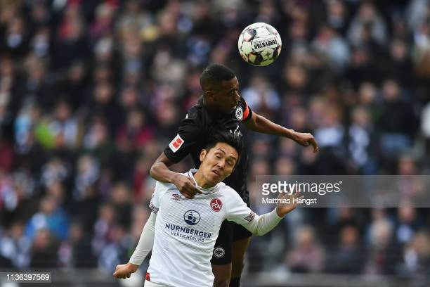 Gelson Fernandes of Eintracht Frankfurt battles for the ball with Yuya Kubo of Nurnberg during the Bundesliga match between Eintracht Frankfurt and 1...