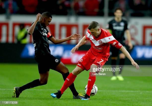 Gelson Fernandes of Eintracht Frankfurt challenges Oliver Fink of Fortuna Dusseldorf during the Bundesliga match between Fortuna Duesseldorf and...