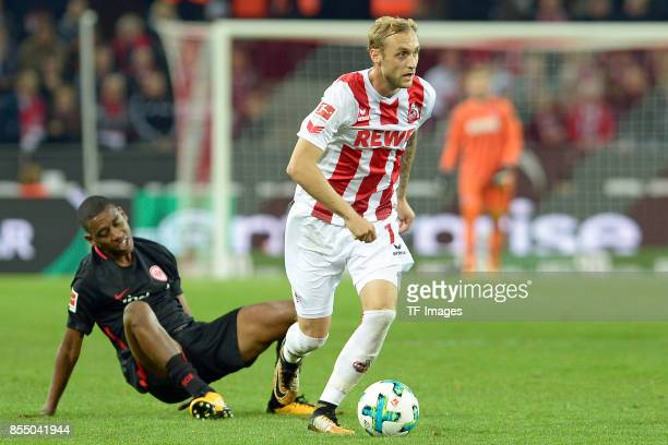 Gelson Fernandes of Frankfurt and Marcel Risse of Koeln battle for the ball during the Bundesliga match between 1 FC Koeln and Eintracht Frankfurt at...