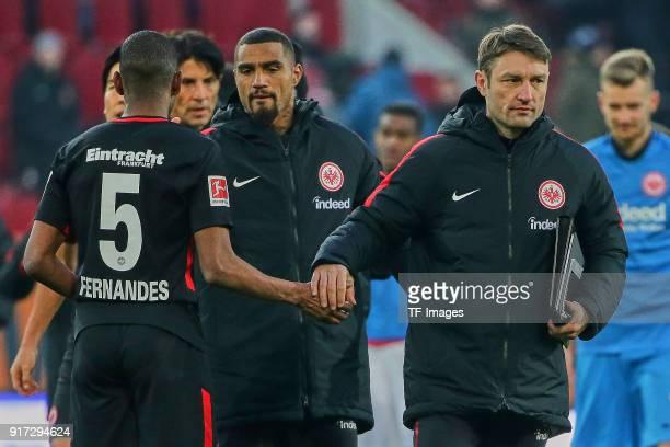 Gelson Fernandes of Frankfurt KevinPrince Boateng of Frankfurt and Assistant coach Robert Kovac of Frankfurt look dejected after the Bundesliga match...