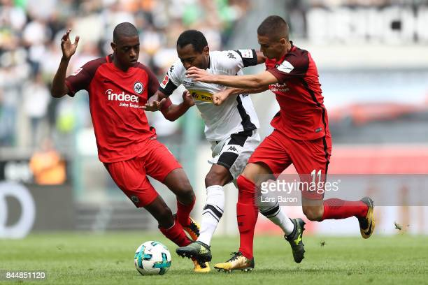 Gelson Fernandes of Frankfurt Raffael of Moenchengladbach and Mijat Gacinovic of Frankfurt fight for the ball during the Bundesliga match between...