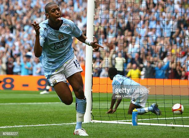 Gelson Fernandes of Manchester City celebrates scoring his team's sixth goal during the Barclays Premier League match between Manchester City and...