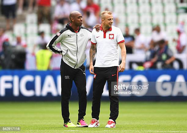 Gelson Fernandes of Switzerland and Kamil Grosicki of Poland talk prior to the UEFA EURO 2016 round of 16 match between Switzerland and Poland at...