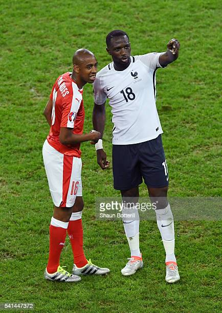 Gelson Fernandes of Switzerland and Moussa Sissoko of France talk after their scoreless draw in the UEFA EURO 2016 Group A match between Switzerland...
