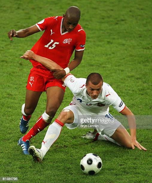 Gelson Fernandes of Switzerland is challenged by Vaclav Sverkos of Czech Republic during the Euro 2008 Group A match between Switzerland and Czech...