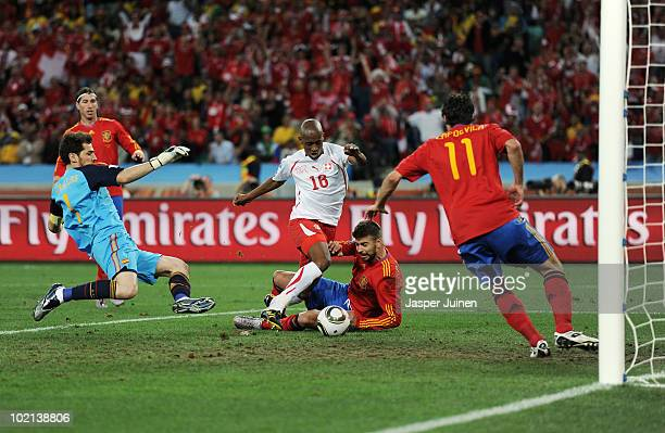 Gelson Fernandes of Switzerland scores the first goal during the 2010 FIFA World Cup South Africa Group H match between Spain and Switzerland at...