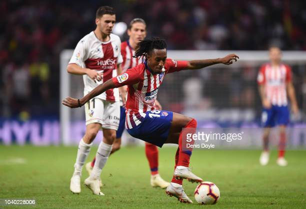 Gelson Martins of Club Atletico de Madrid turns from Alex Gallar of SD Huesca a during the La Liga match between Club Atletico de Madrid and SD...