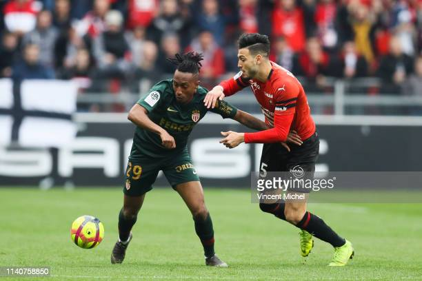 Gelson Martins of Monaco and Rami Bensebaini of Rennes during the Ligue 1 match between Rennes and Monaco on May 1 2019 in Rennes France