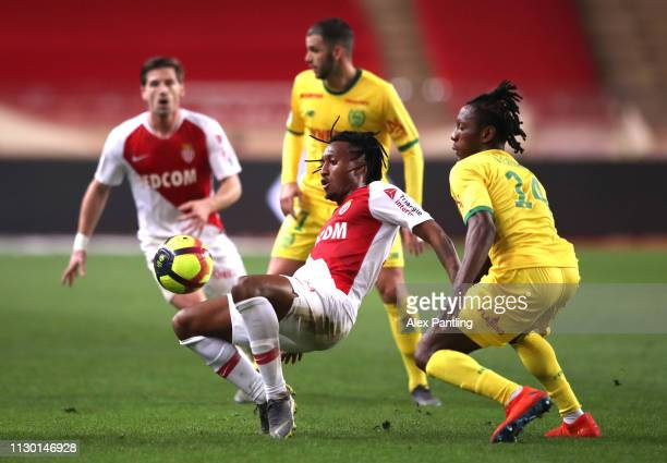 Gelson Martins of Monaco is tackled by Randal Kolo Muani of Nantes during the Ligue 1 match between AS Monaco and FC Nantes at Stade Louis II on...