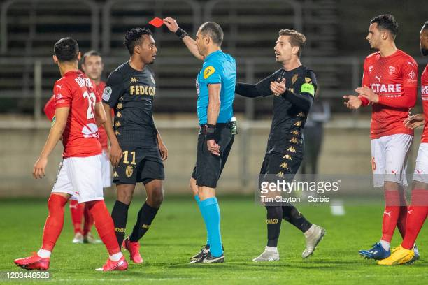 February 01: Gelson Martins of Monaco moves in to push referee Mikael Lesage after receiving a red card during the Nimes V Monaco, French Ligue 1,...