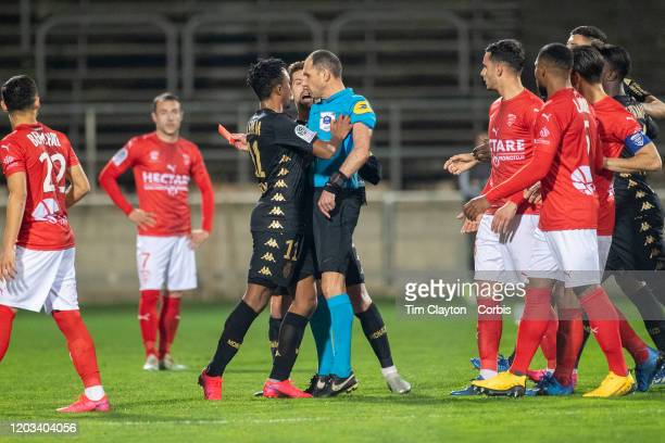 Gelson Martins of Monaco pushes referee Mikael Lesage after receiving a red card during the Nimes V Monaco French Ligue 1 regular season match at...
