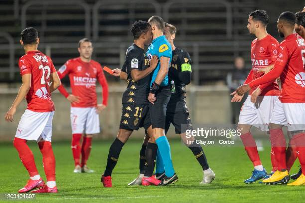 February 01: Gelson Martins of Monaco pushes referee Mikael Lesage after receiving a red card during the Nimes V Monaco, French Ligue 1, regular...