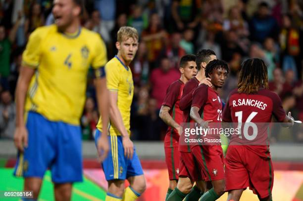 Gelson Martins of Portugal celebrates with team mates after scoring the second against Sweden during the International friendly match between...