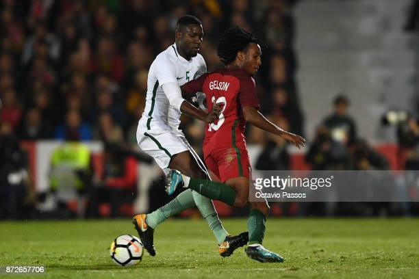 Gelson Martins of Portugal competes for the ball with Omar Othman of Saudi Arabia during the International Friendly match between Portugal and Saudi...