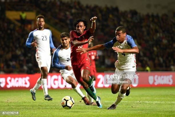 Gelson Martins of Portugal competes for the ball with Tyler Adams of USA during the International Friendly match between Portugal and USA at Estadio...