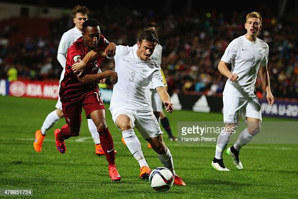 Gelson Martins of Portugal contests with Deklan Wynne of New Zealand during the FIFA U20 World Cup New Zealand 2015 Round of 16 match between...