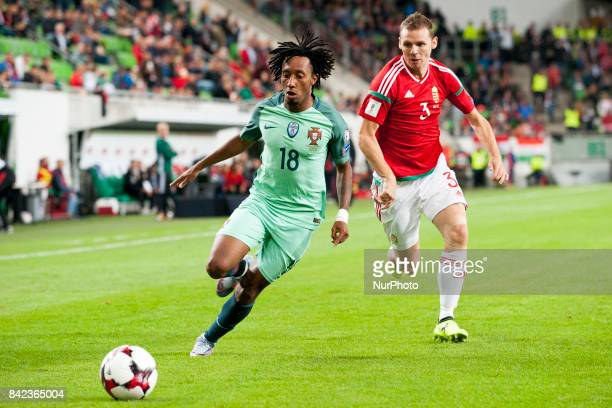 Gelson Martins of Portugal fights for the ball with Mihaly Korhut of Hungary during the FIFA World Cup 2018 Qualifying Round match between Hungary...
