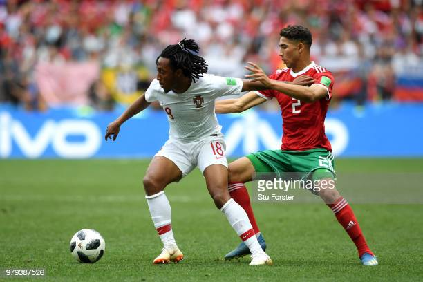 Gelson Martins of Portugal is challenged by Achraf Hakimi of Morocco during the 2018 FIFA World Cup Russia group B match between Portugal and Morocco...