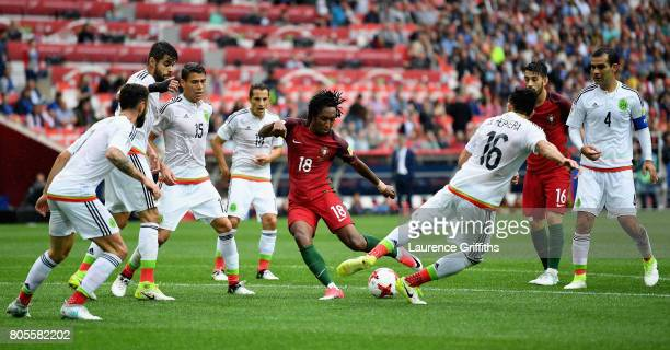 Gelson Martins of Portugal shoots while under pressure from Hector Herrera of Mexico during the FIFA Confederations Cup Russia 2017 PlayOff for Third...
