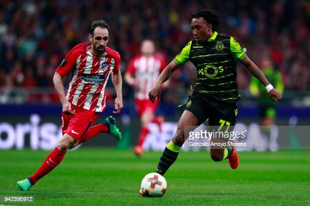 Gelson Martins of Sporting CP competes for the ball with Diego Godin of Atletico de Madrid during the UEFA Europa League quarter final leg one match...