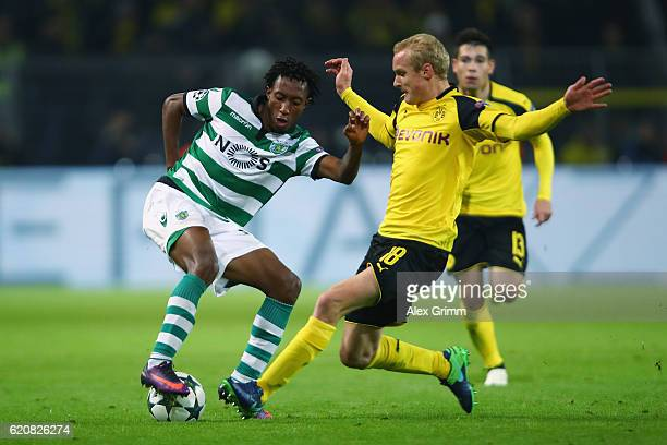 Gelson Martins of Sporting is challenged by Sebastian Rode of Dortmund during the UEFA Champions League Group F match between Borussia Dortmund and...