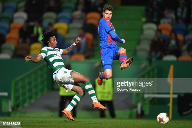 Gelson Martins of Sporting Lisbon competes for the ball with Jan Kovarik of Viktoria Plzen during the UEFA Europa League Round of 16 first leg match...