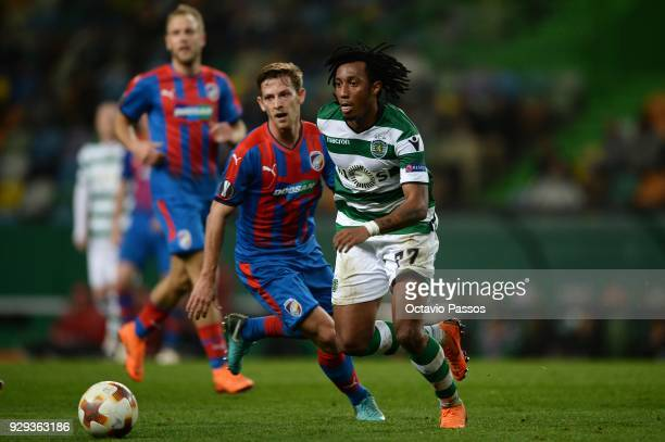 Gelson Martins of Sporting Lisbon competes for the ball with Patrik Hrosovsky of Viktoria Plzen during the UEFA Europa League Round of 16 first leg...