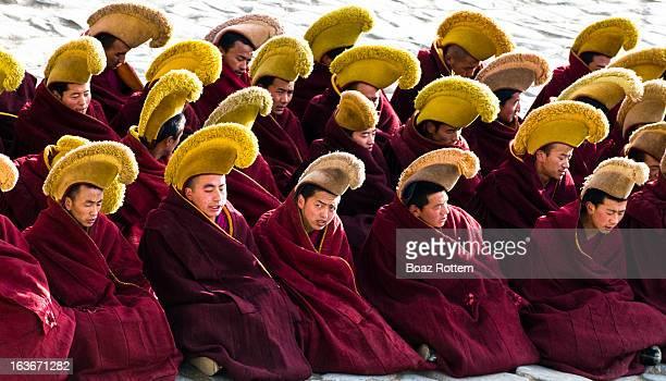 CONTENT] Geluk school Tibetan monks during a ceremony in Labrang monastery in Xiahe