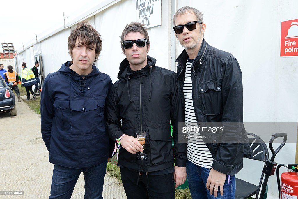 Gem Archer, Liam Gallagher and Andy Bell of Beady Eye pose backstage at day 2 of the 2013 Glastonbury Festival at Worthy Farm on June 28, 2013 in Glastonbury, England.